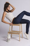Young woman sitting on chair. looking left Royalty Free Stock Photography