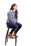 Young woman sitting on a chair Royalty Free Stock Photography
