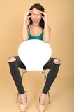 Young Woman Sitting in Chair Screaming with Frustration Stock Photography
