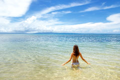 Young woman sitting in clear water on Taveuni Island, Fiji Royalty Free Stock Photos