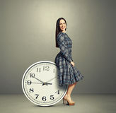 Young woman sitting on a clock Stock Image