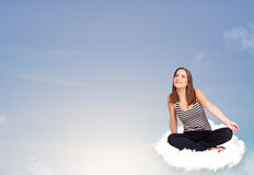 Young woman sitting on cloud with copy space Royalty Free Stock Photos