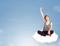 Young woman sitting on cloud with copy space Stock Image