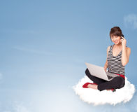 Young woman sitting on cloud with copy space Stock Photos