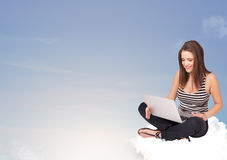 Young woman sitting on cloud with copy space Royalty Free Stock Photography