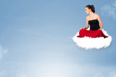 Young woman sitting on cloud with copy space Stock Images