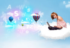 Young woman sitting in cloud with laptop Royalty Free Stock Images