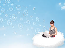 Young woman sitting in cloud with laptop Royalty Free Stock Image