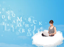 Young woman sitting in cloud with laptop Royalty Free Stock Photography