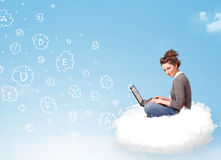 Young woman sitting in cloud with laptop Stock Image