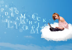 Young woman sitting in cloud with laptop Stock Photo