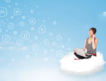 Young woman sitting in cloud with laptop Royalty Free Stock Photos