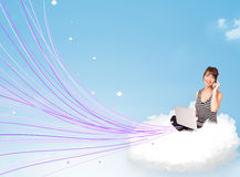 Young woman sitting in cloud with laptop Stock Photos