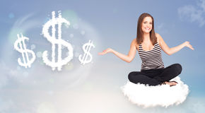 Young woman sitting on cloud next to cloud dollar signs. Pretty young woman sitting on cloud next to cloud dollar signs stock photo