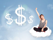 Young woman sitting on cloud next to cloud dollar signs. Pretty young woman sitting on cloud next to cloud dollar signs royalty free stock image