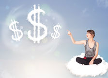 Young woman sitting on cloud next to cloud dollar signs. Pretty young woman sitting on cloud next to cloud dollar signs royalty free stock photos