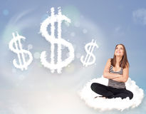 Young woman sitting on cloud next to cloud dollar signs. Pretty young woman sitting on cloud next to cloud dollar signs royalty free stock photography