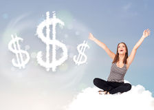 Young woman sitting on cloud next to cloud dollar signs Royalty Free Stock Photo