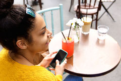 Young woman sitting at coffeeshop Stock Photography