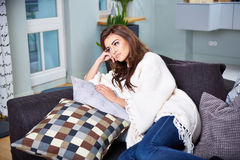 Young woman sitting on couch Royalty Free Stock Photo