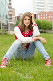 Young woman sitting cross legged Royalty Free Stock Image