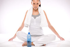 Young woman sitting cross legged after exercises Royalty Free Stock Photos