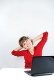 Young woman sitting at desk. Beautiful young woman sitting at desk with laptop stock photography
