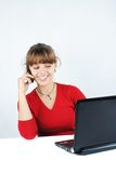 Young woman sitting at desk Royalty Free Stock Photography
