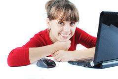 Young woman sitting at desk. Beautiful young woman sitting at desk with laptop stock image