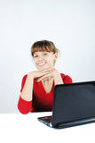 Young woman sitting at desk. Beautiful young woman sitting at desk with laptop royalty free stock photos