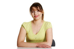 Young woman sitting at the desk Royalty Free Stock Images