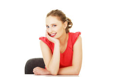 Young woman sitting at the desk Stock Photography