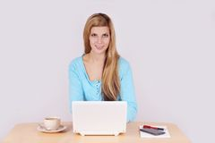 Young woman sitting at desk Stock Photos