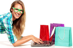 Young Woman Sitting at the desk  shopping Online Royalty Free Stock Photography