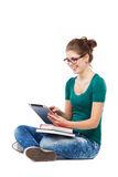 Young woman sitting with digital tablet Royalty Free Stock Image