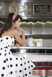 Young Woman Sitting At Diner Counter Stock Photos