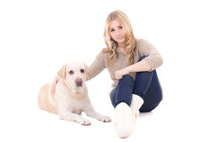Young woman sitting with dog isolated on white Stock Photos