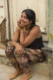 Young woman sitting in doorway Havana Stock Photography