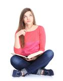 Young woman sitting down on floor Stock Photos