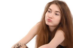 Young woman sitting down sighing unhappy. Royalty Free Stock Photography