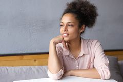 Young woman sitting down and thinking Royalty Free Stock Photography
