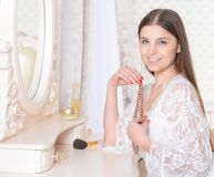 Young woman sitting at dressing table Royalty Free Stock Image