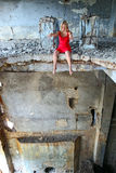 Young woman sitting on the edge in abandoned const Royalty Free Stock Photography