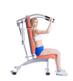 Young woman sitting on exerciser Royalty Free Stock Images