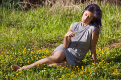 Young Woman Sitting in a Field Stock Photos