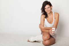 Young woman  sitting on floor Royalty Free Stock Image