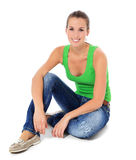 Young woman sitting on the floor Stock Image