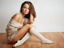 Young woman sitting on  floor Royalty Free Stock Images