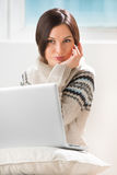 Young woman sitting on the floor in front of laptop Royalty Free Stock Photo