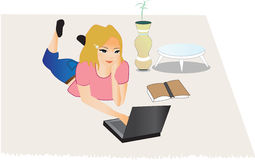 Young woman sitting on floor with a laptop Stock Images